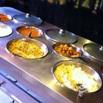 Vegetable, bean curries, white rice, noodle and yellow rice