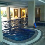 Indoor swimming pool is nice but under dark, low ceiling that is not appealing.