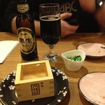 warm sake with black Asahi