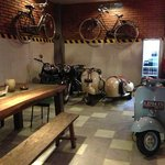 Funky interior displaying owners collection of classic mopeds