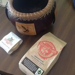 Selection of items available: gourd bowl, handmade soap, and coffee