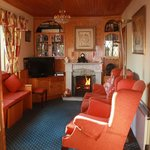 guest lounge on a cold sping evening with a roaring fire