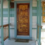 Wood mosaic doors done by local artist reflect images of nature