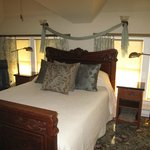 The bedroom of Top of the World Suite glows in the afternoon sunlight