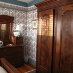 Antique walnut armoire and dresser enhance Helen's Room