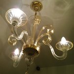 The double room is made more romantic by this Murano chandelier