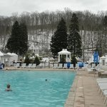 Outdoor pool with snow-capped mountain background