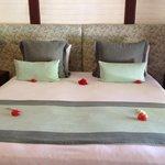Bed in room 113.......fresh flowers everywhere