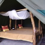 authentic wooden bed frames in one of the tent