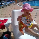my 1 year old daughter enjoying sitting round the pool