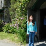 My daughter standing by the front door at Hill Top Farm.