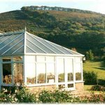 The sunny conservatory and views to the Quantock Hills