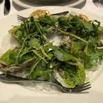 Roasted Oysters en Perseillade with Baby Arugula, preserved lemon