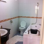 Wet bathroom no shower curtain low water pressure