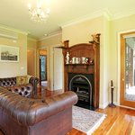 lounge in Yarra Valley cottage with fire place