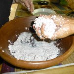 Getting the coconut grated and ready to prepare coconut milk