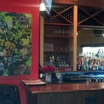 main entry bar and artwork, deep red wine color walls