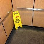 elevator with caution sign