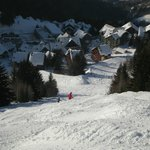 view down black run to Chalet des Neiges apartments