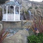 gazebo above pool next to waterfall