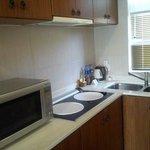 Room has a mini kitchen.
