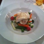 Breton turbot with spring vegetables stack, pickled tomatoes and candied lemon sauce