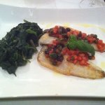 Grilled sea bass with spinach, tomoatoes, capers and taggiasca olives