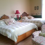 La Doyenne, a large room with 2double beds and private bathroom.