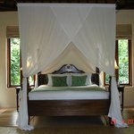 Four Poster bed with beautiful gauze curtains