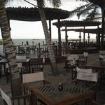 The outdoor dining area (another dining room inside) leads directly to the shore