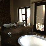huge modern bathroom with large windows overlooking river