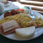 Croquettes, omelette, cold cuts, shredded chicken and fruits