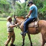 Joe getting the horseback ride ready