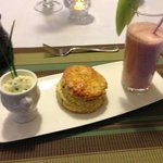 Freshly baked feta scallion scone, chive butter, and strawberry orange smoothie