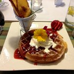 Lemon Belgian Waffles with Strawberry Rhubarb sauce, whipped cream, and maple syrup
