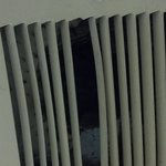 broken vent filled with dust in bathroom.