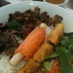 Vermicelli with beef, pork, chicken, shrimp on sugar cane & spring roll