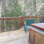The deck of our rustic cabin. Loved the hot tub!