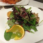 Sunny Side Salad with Fried Goat Cheese, wildflower honey, spiced walnuts and cranberries