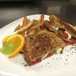 Fried Green tomato sandwich with roasted red pepper and pesto and fresh mozzarella