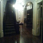 Hull House main stairway.  Cast your eyes toward bottom left of photo - do you see legs and feet