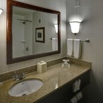 Updated bathrooms include granite countertops and new finishes.
