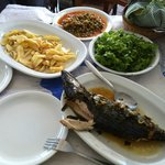 FRIED PATATOES, FISH COOKED CASAROLE (PLAKI), LETTUCE SALAD, FRESH PEAS IN TOMATO SAUCE