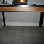 No electricity outlet near the desk! How can the guest work at the desk with his/her laptop?