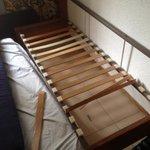 settee bed, broken slates, couldn't sit on never mind sleep on