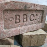 A brick with our distinctive logo