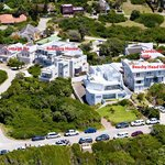 Aerial View of Robberg Beach Lodge showing four villas