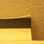 Top of bed headboard coming apart. A simple glue job would fix this.