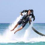Chris flying on Seven Mile Beach