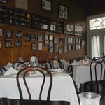 Tujague's dining room, walls filled with celebrity pics